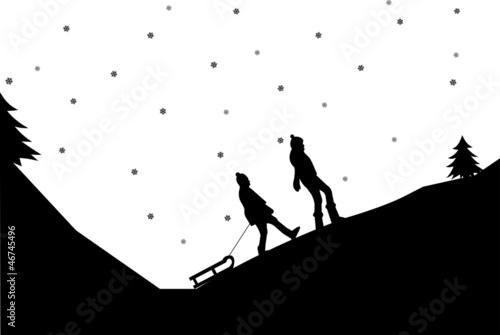 Sledding girls in mountain in winter silhouette