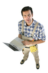 Male artisan worker holding laptop