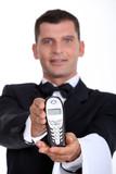 Waitor giving telephone