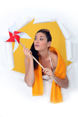 woman holding a windmill toy