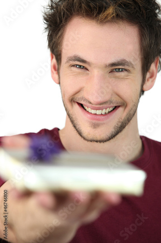 Smiling man with a present