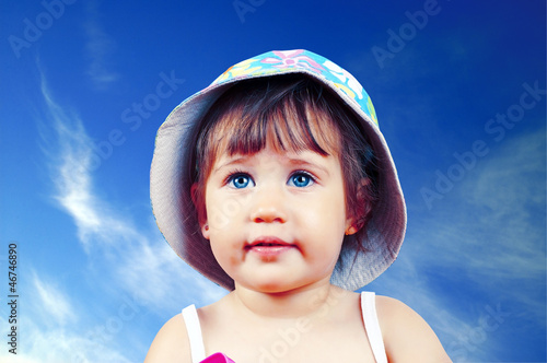 Portrait of pretty blue-eyed girl in a hat