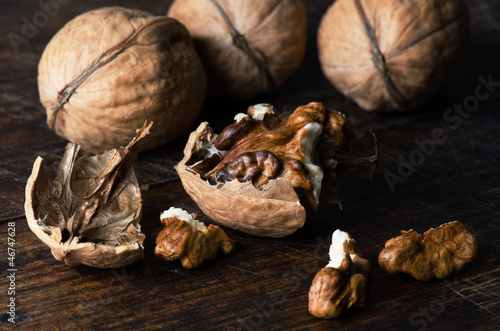 Walnuts on wooden table close up