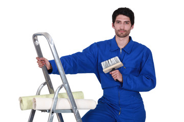 craftsman painter climbing on a ladder