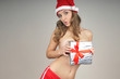 Christmas naked girl  covered  gift wearing Santa hat