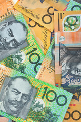 Australian currency background, notes include $100 and $50