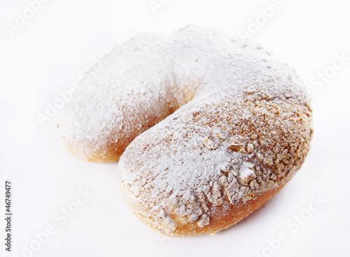 Freshly baked bun dusted with sugar powder