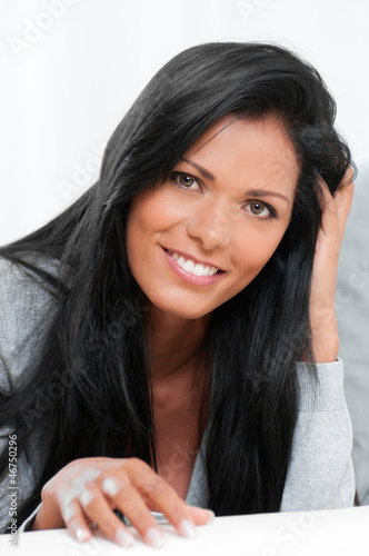 Happy relaxing woman smiling