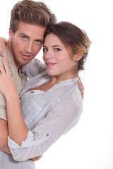 Young couple embraced, studio shot