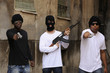 Gang members with guns and rifle on the street