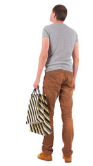 Back view of handsome man with shopping bags