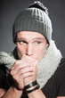 Winter fashion portrait of urban young man wearing woolen hat.