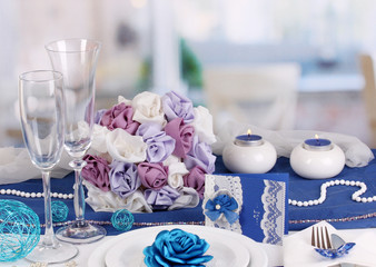 Serving fabulous wedding table in purple and blue color of the