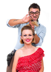 Male hairdresser, make hairstyle from woman, isolated on white