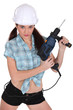 Sexy woman with drill