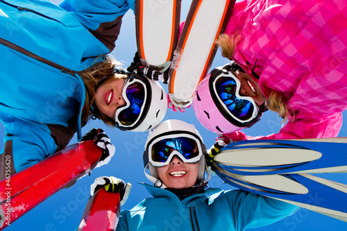 Ski, snow, sun and winter fun - happy  ski team
