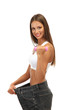 beautiful young woman with big jeans and  dumbbells, isolated