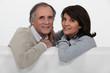 Mature couple sitting on a sofa