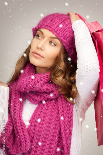 woman with shopping bags with snow