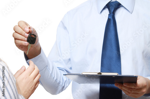 Unknown businessman giving key to his female