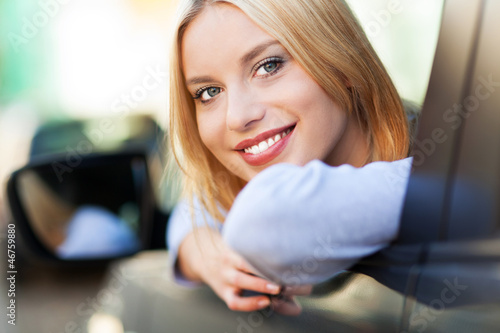 Young woman sitting in car