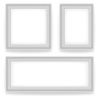 Blank white wall picture frames isolated on white