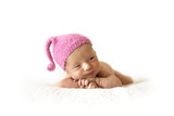 cute newborn baby in a pink berry cap on white background
