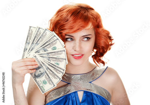 Young happy woman with dollar notes in hand. Isolated on white b