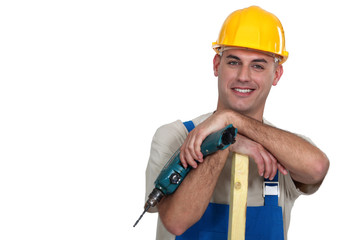 Craftsman with wood and drill