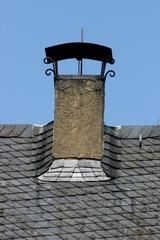 Chimney hood on slate roof