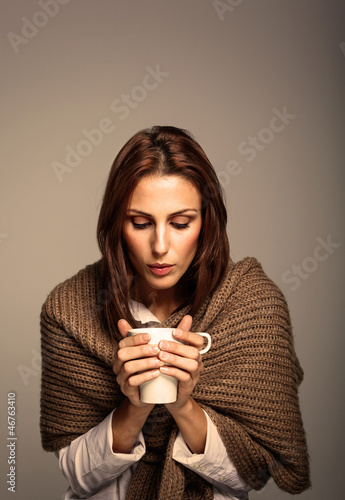 Attractive Woman Drinking a Hot Coffee
