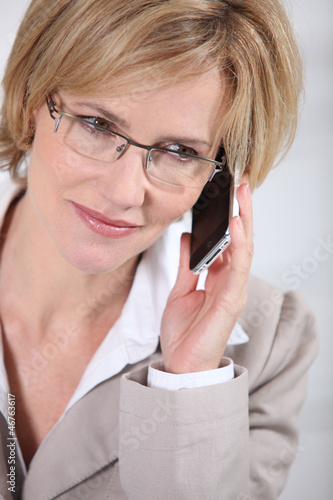Businesswoman making call
