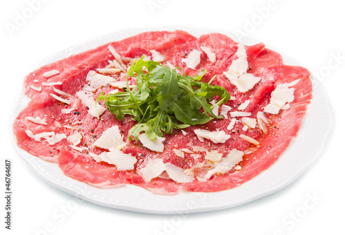carpaccio of beef on arugula