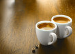 Two cups of freshly brewed espresso coffee