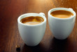 Two espressos with a single coffee bean