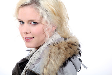 Portrait of blonde woman with coat