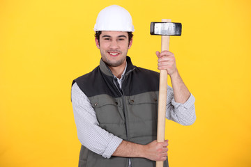 craftsman holding a  hammer
