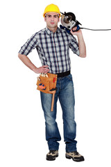 Man confidently holding circular saw