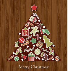 Christmas tree on a wooden background