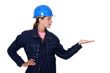 Woman with helmet gesturing on white background