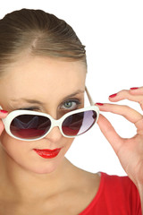 elegant woman looking over her sunglasses