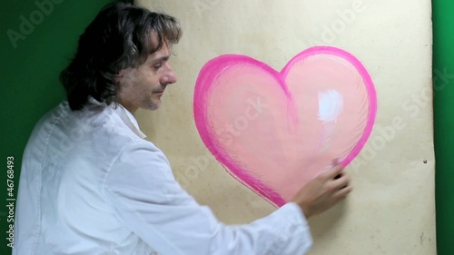 Artist drawing Heart with pastel