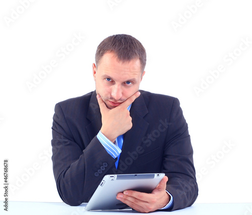 business man sitting at his office and using his modern tablet