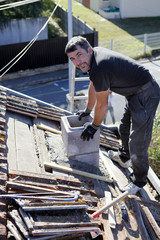 Roofer replacing shingles