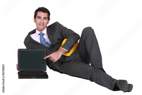 Architect with a blank laptop