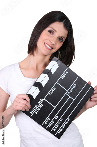 Friendly woman with a clapperboard