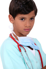 Young boy pretending to be a doctor