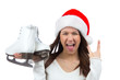 Woman with ice skates сhristmas santa hat screaming