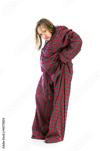young girl wearing huge pajamas