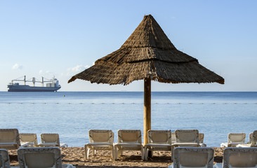 Sunshade and beds facilities on sandy beach of Eilat